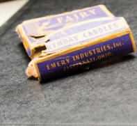 A tore box of emery candles